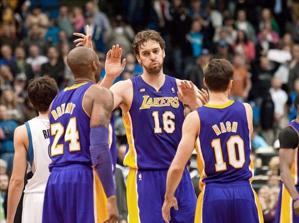 Mar 27, 2013; Minneapolis, MN, USA; Los Angeles Lakers power forward Pau Gasol (16) congratulates teammates Kobe Bryant (24) and Steve Nash (10) at the end of the fourth quarter at Target Center. Lakers won 120-117. Mandatory Credit: Greg Smith-USA TODAY Sports