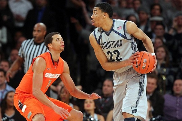 Mar 15, 2013; New York, NY, USA; Georgetown Hoyas forward Otto Porter (22) controls the ball against Syracuse Orange guard Michael Carter-Williams (1) during the second half of a semifinal game of the Big East tournament at Madison Square Garden. Mandatory Credit: Brad Penner-USA TODAY Sports