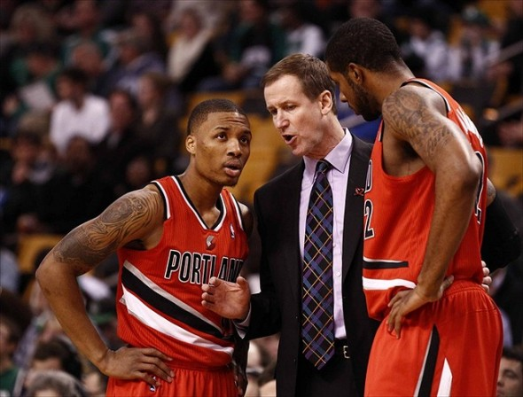 Nov 30, 2012; Boston, MA, USA; Portland Trail Blazers head coach Terry Stotts (center) speaks with Portland Trail Blazers point guard Damian Lillard (left) and power forward LaMarcus Aldridge (right) during the first half of a game against the Boston Celtics at TD Garden. Mandatory Credit: Mark L. Baer-USA TODAY Sports