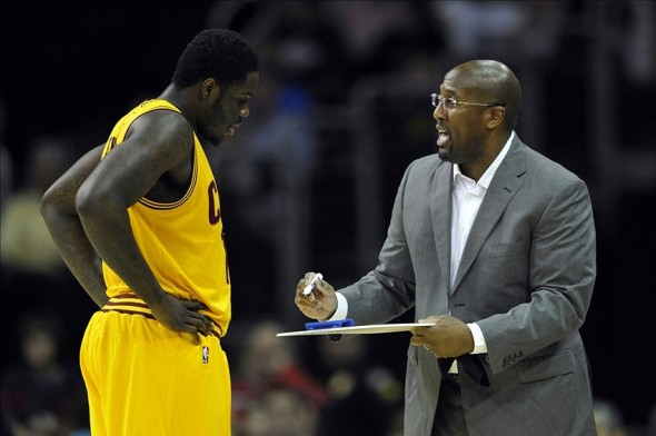 Oct 8, 2013; Cleveland, OH, USA; Cleveland Cavaliers head coach Mike Brown talks to power forward Anthony Bennett (15) in the first quarter against the Milwaukee Bucks at Quicken Loans Arena. Mandatory Credit: David Richard-USA TODAY Sports