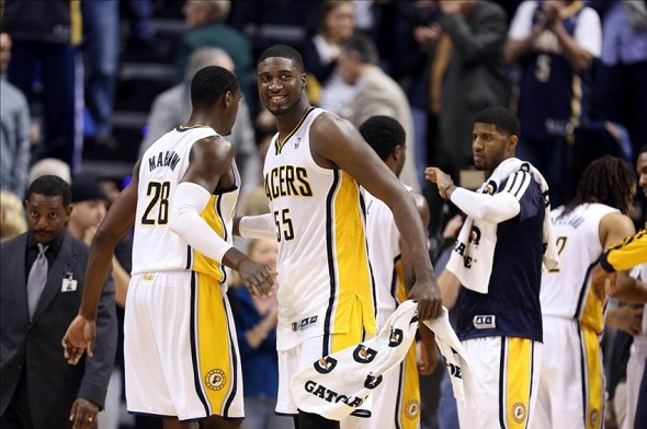 Nov 15, 2013; Indianapolis, IN, USA; Indiana Pacers centers Roy Hibbert (55) and Ian Mahinmi (28) celebrate the victory against the Milwaukee Bucks at Bankers Life Fieldhouse. Indiana defeats Milwaukee 104-77. Mandatory Credit: Brian Spurlock-USA TODAY Sports