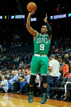 Apr 9, 2014; Atlanta, GA, USA; Boston Celtics guard Rajon Rondo (9) attempts a three in the first quarter against the Atlanta Hawks at Philips Arena. Mandatory Credit: Daniel Shirey-USA TODAY Sports
