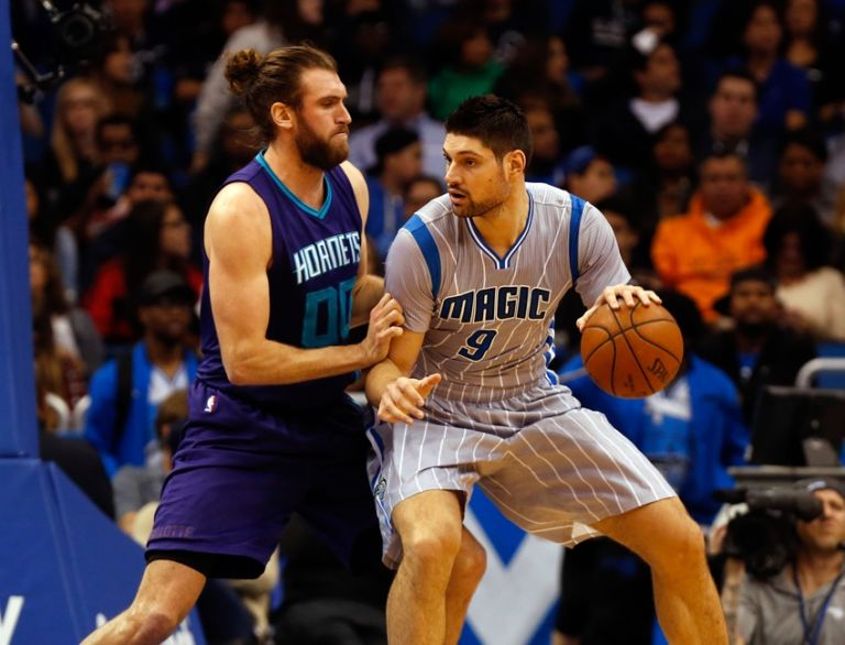 9109853-spencer-hawes-nikola-vucevic-nba-charlotte-hornets-orlando-magic-768x586