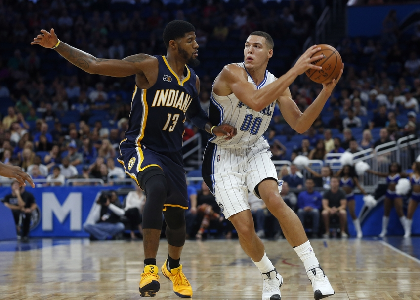 Oct 14, 2016; Orlando, FL, USA; Orlando Magic forward Aaron Gordon (00) drives to the basket as Indiana Pacers forward Paul George (13) defends during the second half at Amway Center. Orlando Magic defeated the Indiana Pacers 114-106. Mandatory Credit: Kim Klement-USA TODAY Sports