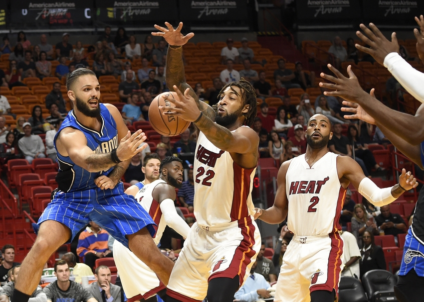 9616466-evan-fournier-derrick-williams-nba-preseason-orlando-magic-miami-heat