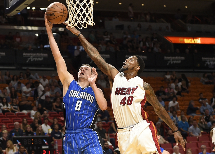 Oct 18, 2016; Miami, FL, USA; Miami Heat forward Udonis Haslem (40) fouls Orlando Magic guard Mario Hezonja (8) during the first half at American Airlines Arena. Mandatory Credit: Steve Mitchell-USA TODAY Sports