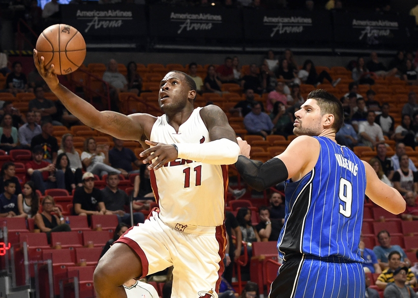 9616773-nikola-vucevic-dion-waiters-nba-preseason-orlando-magic-miami-heat