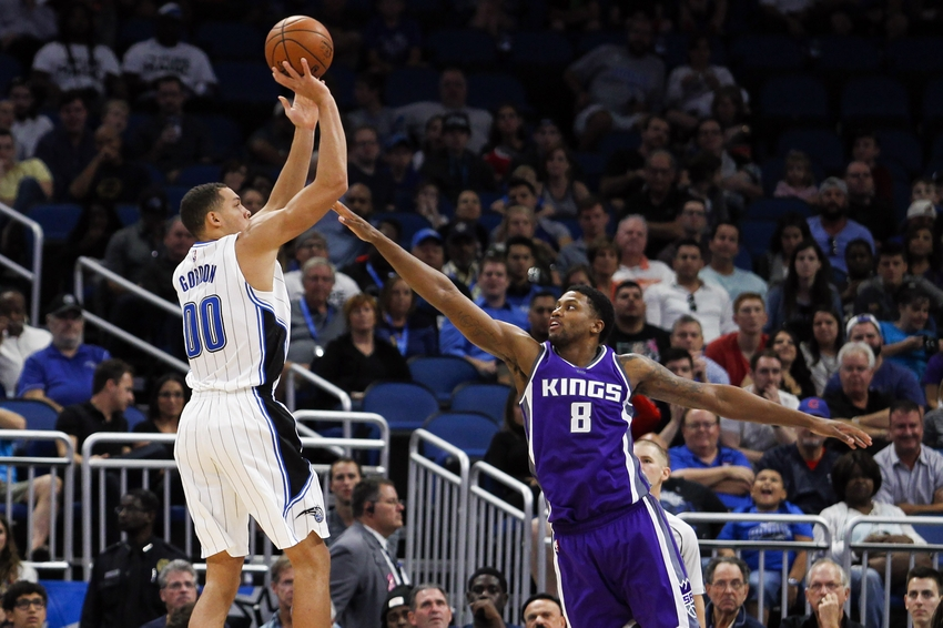 Nov 3, 2016; Orlando, FL, USA; Orlando Magic forward Aaron Gordon (00) takes a shot in the second quarter as Sacramento Kings forward Rudy Gay (8) defends at Amway Center. Mandatory Credit: Logan Bowles-USA TODAY Sports