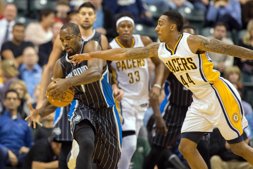 Nov 14, 2016; Indianapolis, IN, USA; Orlando Magic forward Serge Ibaka (7) pulls down a rebound while Indiana Pacers guard Jeff Teague (44) defends in the first quarter of the game at Bankers Life Fieldhouse. Mandatory Credit: Trevor Ruszkowski-USA TODAY Sports