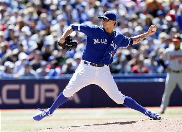 May 25, 2013; Toronto, Ontario, CAN; Toronto Blue Jays pitcher Brett Cecil (27) pitches against the Baltimore Orioles at the Rogers Centre. Baltimore defeated Toronto 6-5. Mandatory Credit: John E. Sokolowski-USA TODAY Sports