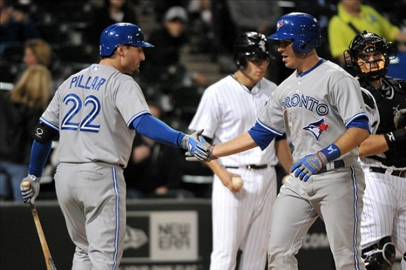 Sep 23, 2013; Chicago, IL, USA; Toronto Blue Jays catcher J.P. Arencibia (9) is congratulated by left fielder Kevin Pillar (22) for hitting a home run against the Chicago White Sox during the fifth inning at U.S Cellular Field. Mandatory Credit: Rob Grabowski-USA TODAY Sports