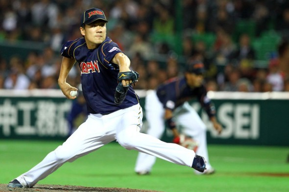 Masahiro Tanaka delivers a pitch in the WBC vs Cuba. Mandatory Credit: Koji Watanabe/Getty Images AsiaPac