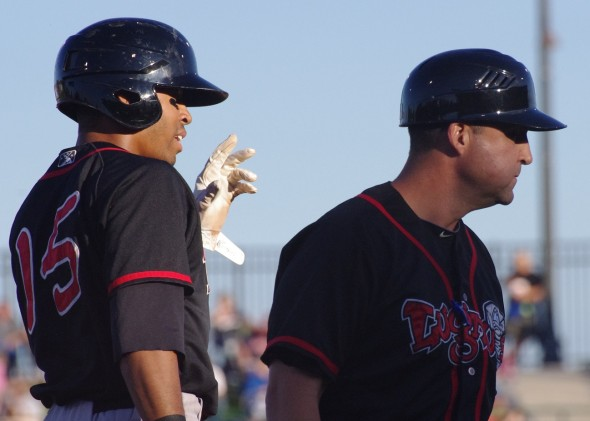 Lansing Lugnuts center fielder Dalton Pompey (left) and manager John Tamargo after Pompey made it to third base in a game against the Great Lakes Loons on August 10, 2013. Mandatory Credit: Jay Blue