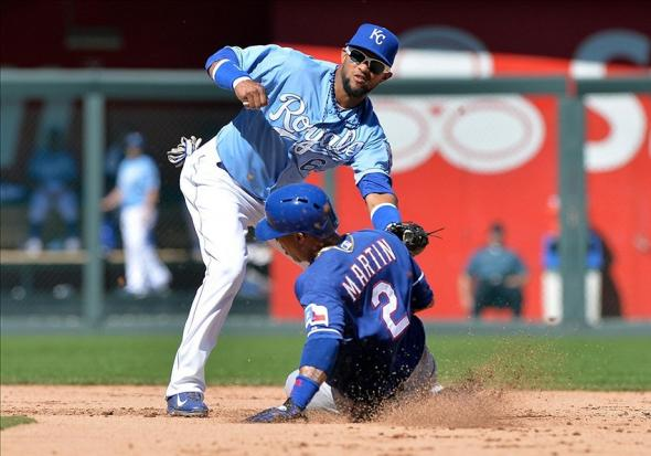 Sep 22, 2013; Kansas City, MO, USA; Kansas City Royals second basemen Emilio Bonifacio (64) tags out Texas Rangers base runner Leonys Martin (2) attempting to steal second during the fifth inning at Kauffman Stadium. Mandatory Credit: Peter G. Aiken-USA TODAY Sports