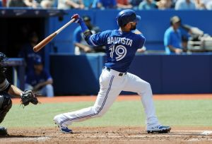 Toronto Blue Jays right fielder Jose Bautista hits a two-run home run in the first inning against New York Yankees at Rogers Centre. Mandatory Credit: Dan Hamilton-USA TODAY Sports