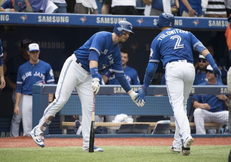 9461799-justin-smoak-troy-tulowitzki-mlb-houston-astros-toronto-blue-jays-768x537