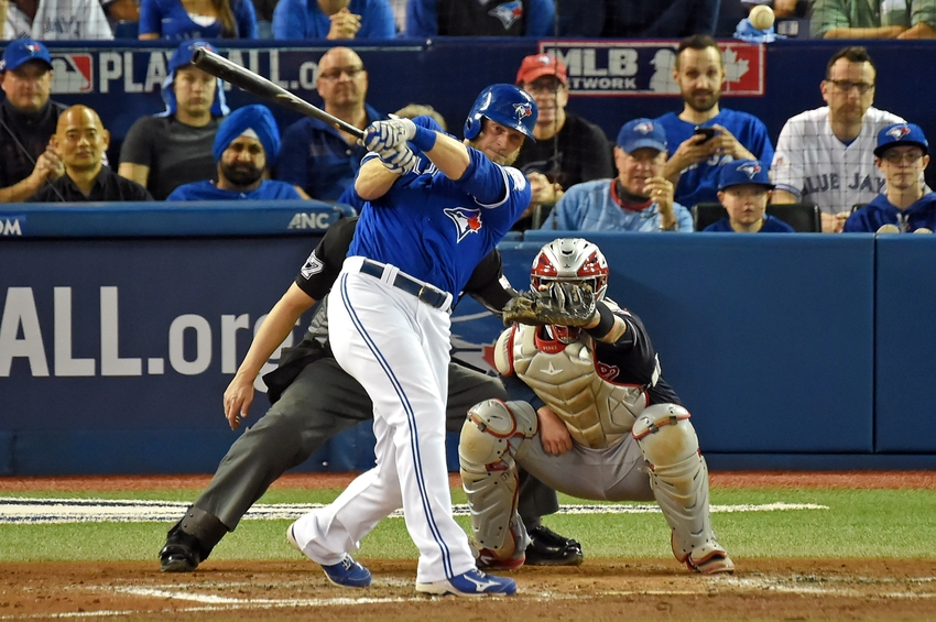 9619035-michael-saunders-mlb-alcs-cleveland-indians-toronto-blue-jays