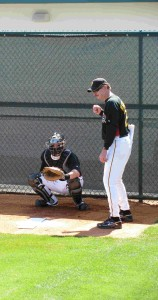 "Kerrigan with 4"" mat target on plate while Doumit awaits Gorzy's pitch"