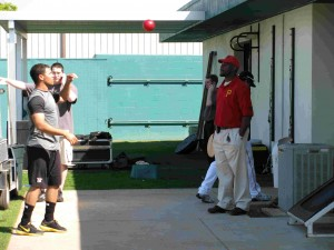 Ian Snell works with throwing a weighted ball during Spring Training.