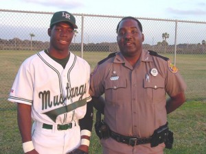Tony Milledge, Florida Highway Patrol and his son Lastings. Sarasota Tribune