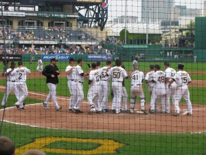 Brandon Moss circles the bases after a walkoff homer against the Brewers