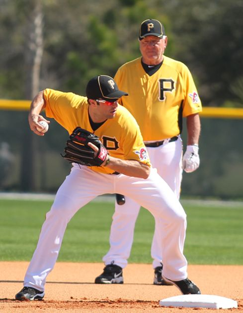 Bill Mazeroski looks on while Neil Walker works at second base.