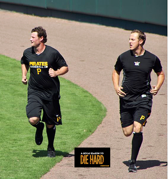 Gerrit Cole and Jameson Taillon run along the outfield track at McKechnie Field.