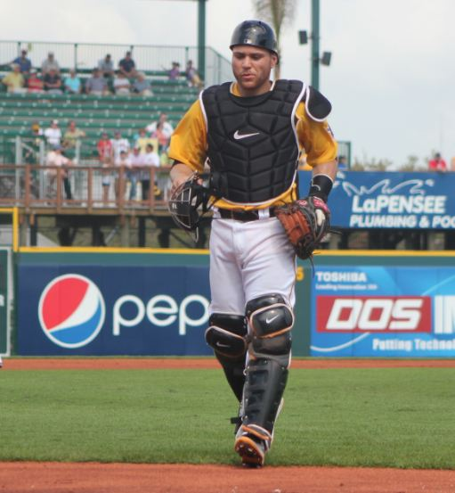 Pirates Russell Martin heads back to homeplate after talking with his starter.
