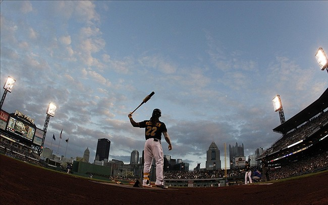 Sep 13, 2013; Pittsburgh, PA, USA; Pittsburgh Pirates center fielder Andrew McCutchen (22) prepares to bat in the on-deck circle against the Chicago Cubs during the first inning at PNC Park. Mandatory Credit: Charles LeClaire-USA TODAY Sports