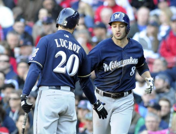 Apr 6, 2014; Boston, MA, USA; Milwaukee Brewers catcher Jonathan Lucroy (20) congratulates left fielder Ryan Braun (8) after scoring a run during the eighth inning against the Boston Red Sox at Fenway Park. Mandatory Credit: Bob DeChiara-USA TODAY Sports