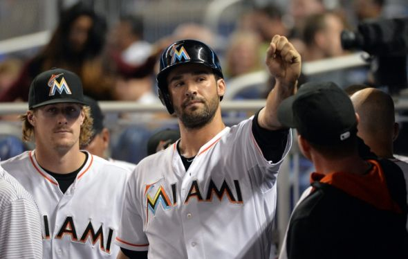 Jun 3, 2014; Miami, FL, USA; Miami Marlins first baseman Garrett Jones (46) celebrates in the dugout after scoring a run during the fifth inning against the Tampa Bay Rays at Marlins Ballpark. The Marlins won 1-0. Mandatory Credit: Steve Mitchell-USA TODAY Sports