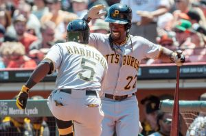 Jul 30, 2014; San Francisco, CA, USA; Pittsburgh Pirates third baseman Josh Harrison (5) and center fielder Andrew McCutchen (22) celebrate after Harrison hit a home run against the San Francisco Giants during the third inning at AT&T Park. Mandatory Credit: Ed Szczepanski-USA TODAY Sports