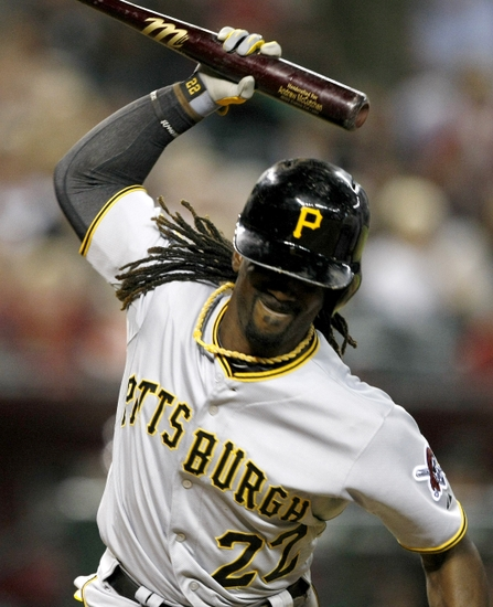 Aug 2, 2014; Phoenix, AZ, USA; Pittsburgh Pirates center fielder Andrew McCutchen (22) reacts after getting hit with a pitch in the ninth inning against the Arizona Diamondbacks at Chase Field. Mandatory Credit: Rick Scuteri-USA TODAY Sports