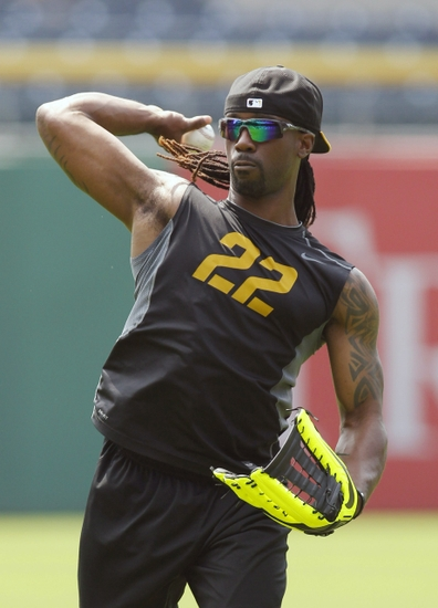 Aug 10, 2014; Pittsburgh, PA, USA; Pittsburgh Pirates center fielder Andrew McCutchen (22) plays catch on the field before playing the San Diego Padres at PNC Park. Mandatory Credit: Charles LeClaire-USA TODAY Sports