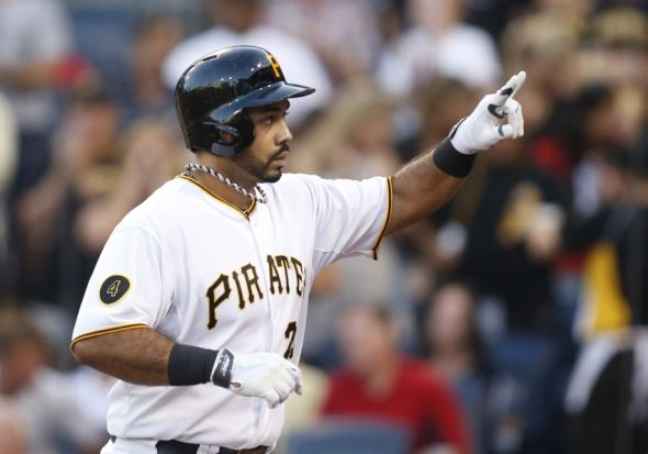 Aug 25, 2014; Pittsburgh, PA, USA; Pittsburgh Pirates first baseman Pedro Alvarez (24) reacts after hitting a solo home run against the St. Louis Cardinals during the second inning at PNC Park. Mandatory Credit: Charles LeClaire-USA TODAY Sports