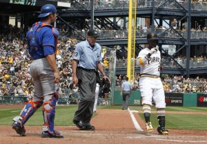 May 24, 2015; Pittsburgh, PA, USA; Pittsburgh Pirates center fielder Andrew  McCutchen (22) crosses home plate after hitting a two run home run as New York Mets catcher <a rel=