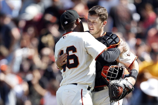 July 15, 2012; San Francisco, CA, USA; San Francisco Giants pitcher Santiago Casilla (46) embraces catcher Buster Posey after defeating the Houston Astros 3 to 2 at AT