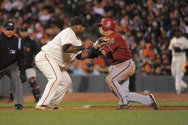 Arizona Diamondbacks shortstop, John McDonald, collides with San Francisco Giants' third baseman, Pablo Sandoval.