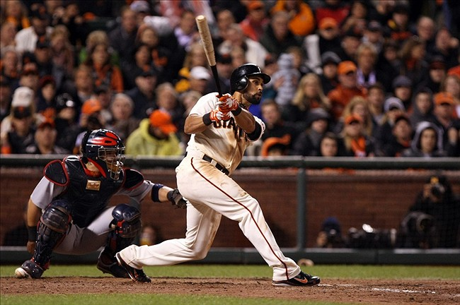 Oct 22, 2012; San Francisco, CA, USA; San Francisco Giants center fielder Angel Pagan (16) hits a single against the St. Louis Cardinals during the seventh inning of game seven of the 2012 NLCS at AT
