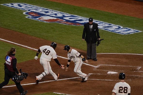 Pablo Sandoval is congratulated by Marco Scutaro