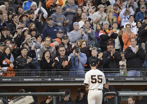 Apr 20, 2013; San Francisco, CA, USA; San Francisco Giants pitcher Tim Lincecum (55) leaves the game during the seventh inning while fans applaud his effort against the San Diego Padres at AT