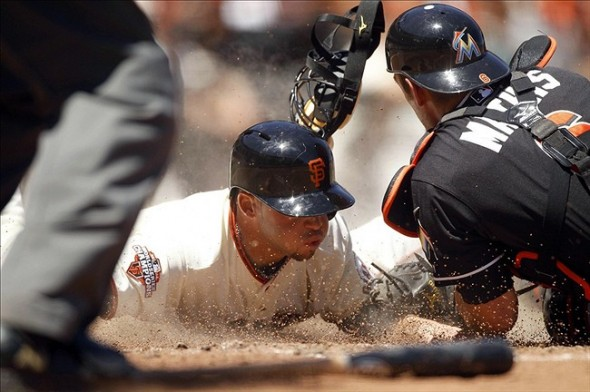 San Francisco Giants' Juan Perez is tagged out at the plate.