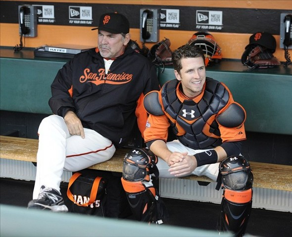 Jul 26, 2013; San Francisco, CA, USA;San Francisco Giants catcher Buster Posey (28) and manager Bruce Bochy (15) in the dugout before the game against the Chicago Cubs at AT