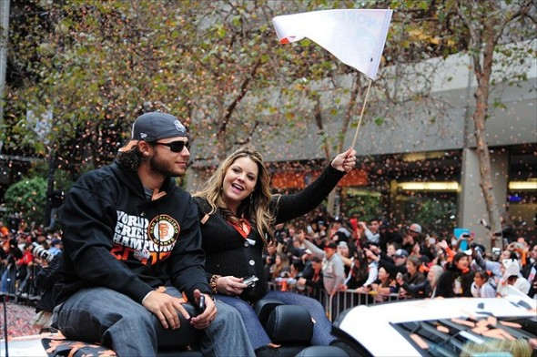 October 31, 2012; San Francisco, CA, USA; San Francisco Giants shortstop Brandon Crawford (left) and wife Jalynne Dantzscher Crawford (right) ride in a car during the World Series victory parade at Market Street. The Giants defeated the Detroit Tigers in a four-game sweep to win the 2012 World Series. Mandatory Credit: Kyle Terada-USA TODAY Sports