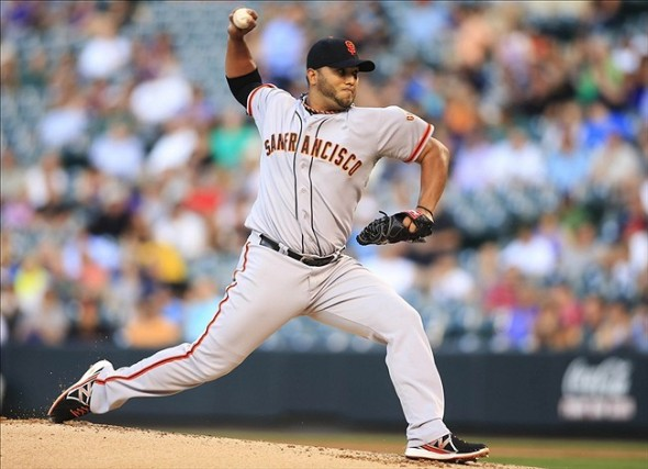 Aug 27, 2013; Denver, CO, USA; San Francisco Giants pitcher Yusmeiro Petit (52) delivers a pitch during the first inning against the Colorado Rockies at Coors Field.. Mandatory Credit: Chris Humphreys-USA TODAY Sports