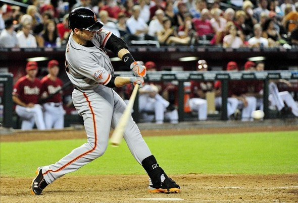 Sept 1, 2013; Phoenix, AZ, USA; San Francisco Giants catcher Buster Posey (28) hits a single during the seventh inning against the Arizona Diamondbacks at Chase Field. Mandatory Credit: Matt Kartozian-USA TODAY Sports