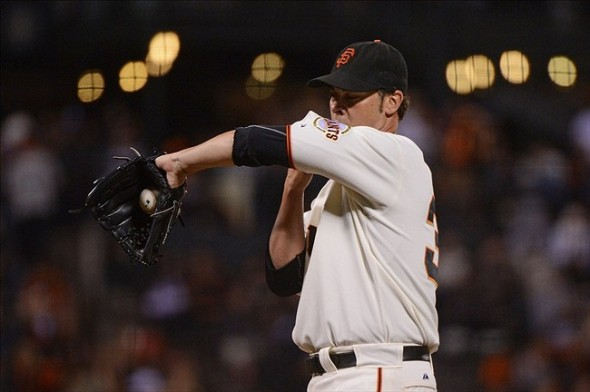 September 5, 2013; San Francisco, CA, USA; San Francisco Giants starting pitcher Ryan Vogelsong (32) wipes his face during the fifth inning against the Arizona Diamondbacks at AT
