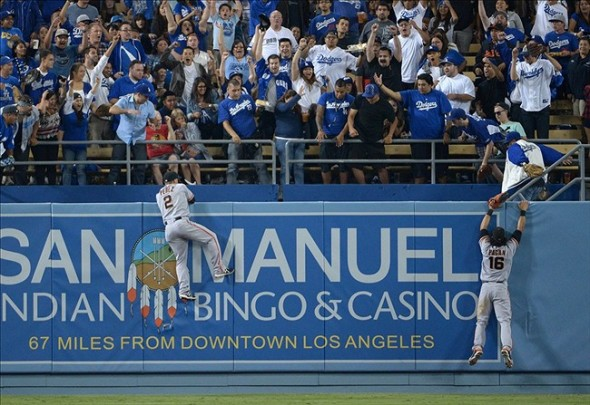 Juan Perez climbs wall for Uribe's home run