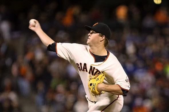 Sep 24, 2013; San Francisco, CA, USA; San Francisco Giants starting pitcher Matt Cain (18) pitches the ball against the Los Angeles Dodgers during the second inning at AT