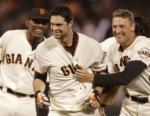 Brandon Belt, with Joaquin Arias and Hunter Pence